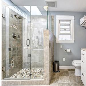 Modern bathroom interior with glass door